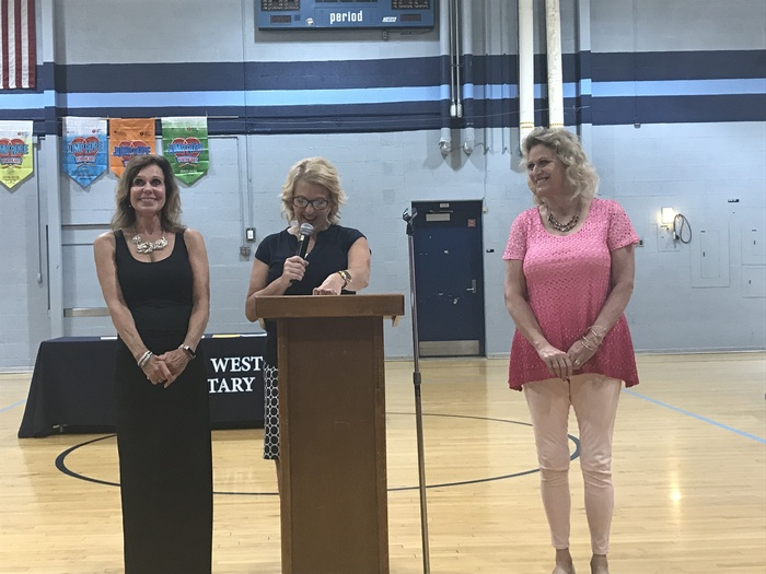 Mrs. Brand and Mrs. Render honored at the Awards Assembly.