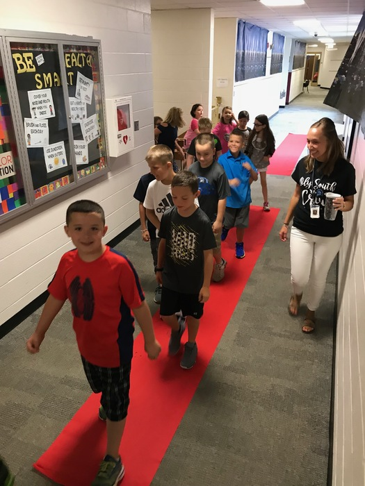 Students walk the Red Carpet on the way to class this morning!