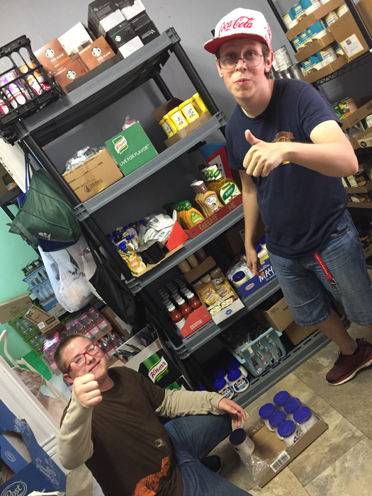 Brenden and Dylan stocking shelves- thumbs up!