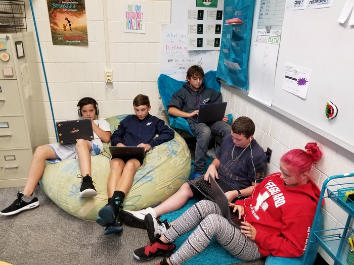 Students find a comfy place to write their blogs.