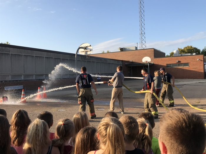 Mr. Ferguson and Mrs. Read try using the fire hoses.