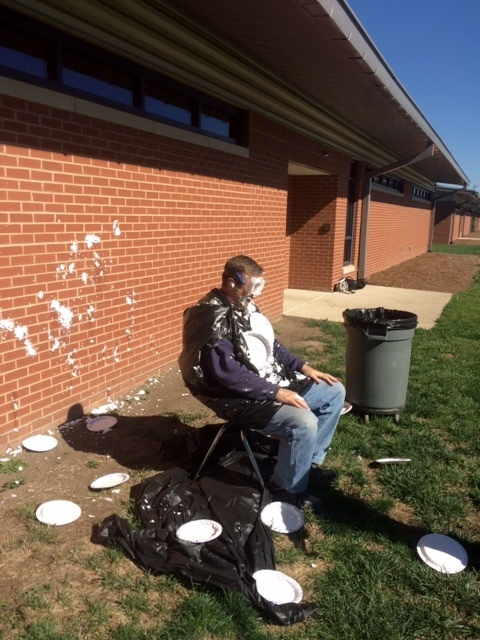 Mr. Hurley getting hit with pies