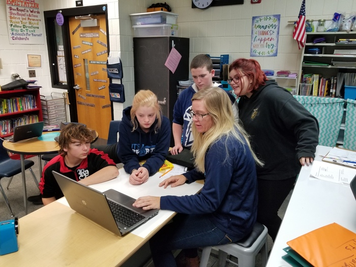 8th graders make a video response to share with students in Russia.