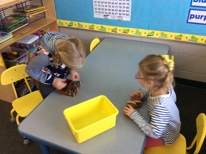PM students playing with treasure and treasure chests in Math Center.