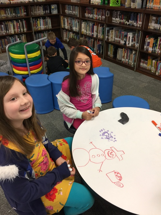 Drawing on the Dry Erase tables!
