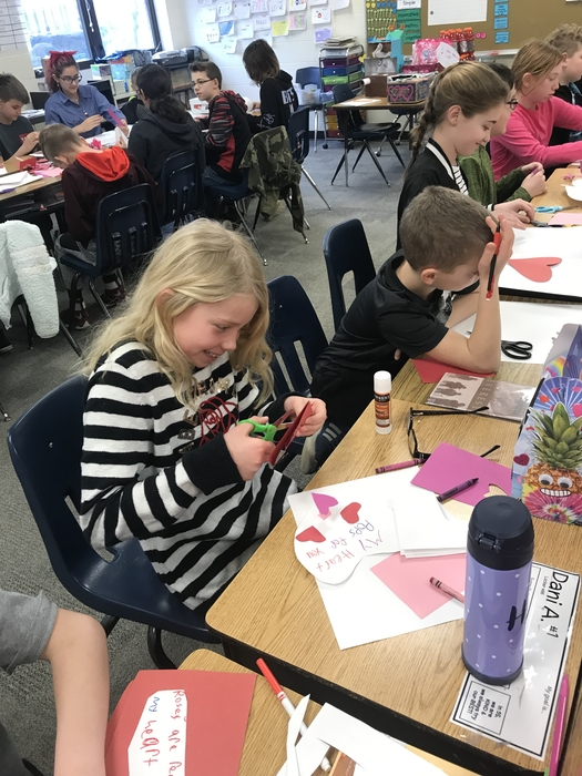 5th Graders Creating Valentines.