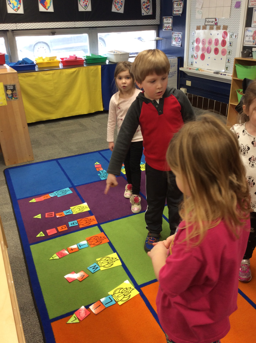 Working together to create the letter rocket ships.