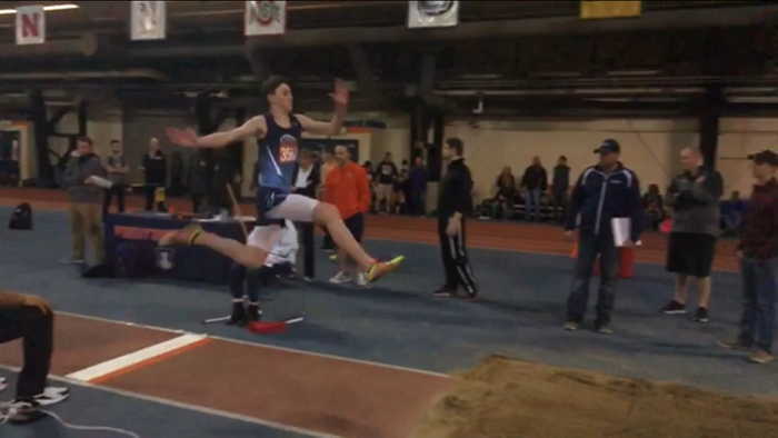 Andrew Litwiller skies in the long jump