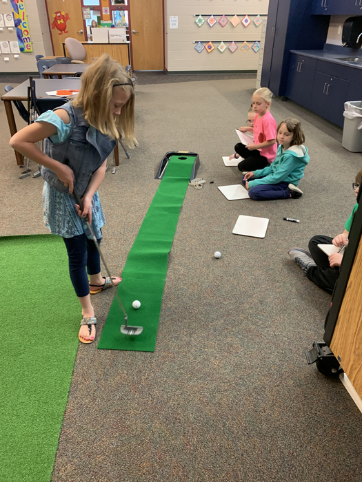 Putting to estimate length from hole!
