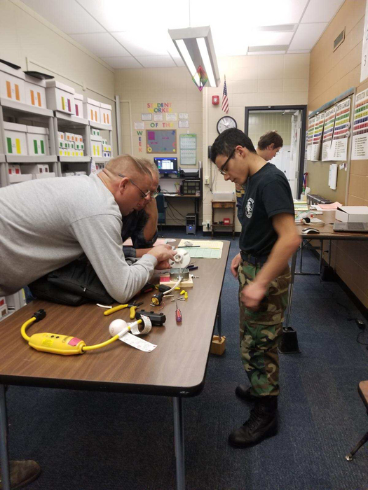 Jimmy and Caleb working on an electrical project