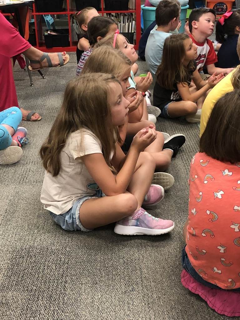 1st graders practicing breathing techniques.