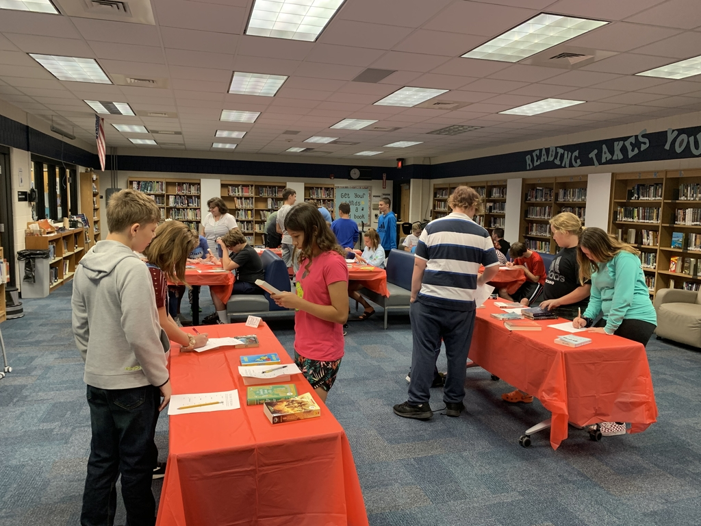 7th grade students participate in a book tasting.