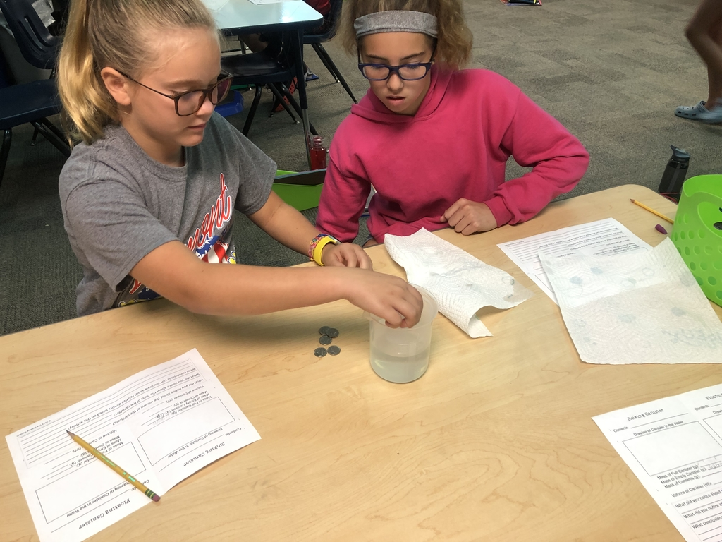5th graders investigating mass, density and volume.