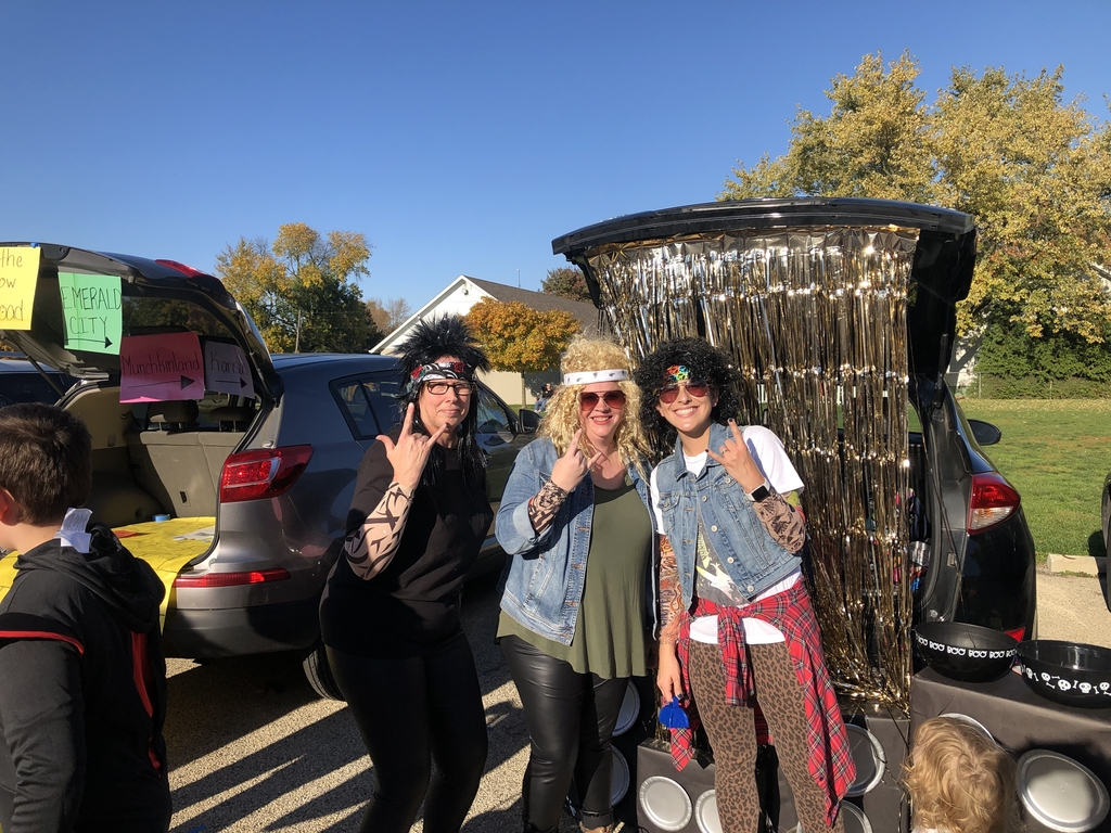 Mrs. Tibbs, Mrs. Gray and Mrs. Estes rockin' out at the Trunk or Treat event.